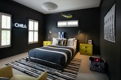 Sally Wheat Interiors tween boy's bedroom, charcoal gray with pops of yellow, neon sign