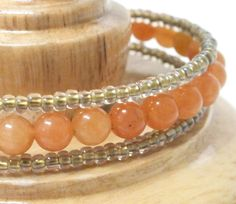 Memory Wire Bangle Bracelet of Orange Aventurine and small l translucent beads. by Mostly Beads, $22.00 USD
