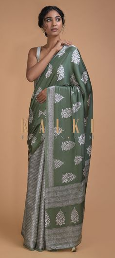 Buy Online from the link below. We ship worldwide (Free Shipping over US$100)  Click Anywhere to Tag Russian Green Half And Half Saree With Leaf Motifs And Geometric Pattern Online - Kalki Fashion Russian green satin blend saree in half and half pattern.Pleats adorned with printed geometric pattern.