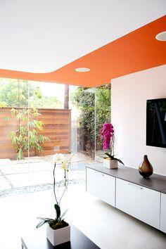 Orange ceiling in modern living room