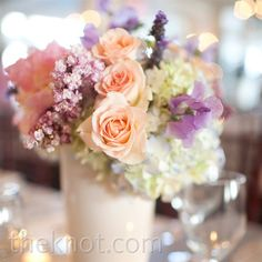 Email      Print      5    Low centerpieces, filled with soft-colored blooms, captured a look of understated elegance.  Soft colors would look good with BM dresses