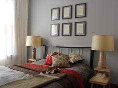 graue Wandfarbe, Holz Nachttische und schwarzer Bettrahmen