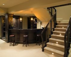 gorgeous basement-- round bar, lights on the stairs
