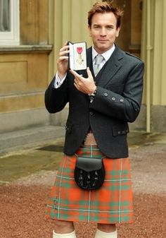 Ewan McGregor collects OBE medal from Prince Charles