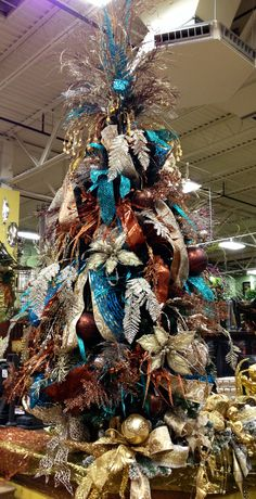 #Christmas Tree in gold, champagne, chocolate and teal! Isn't that gorgeous? At #Arcadia Floral & Hone Decor Showroom.