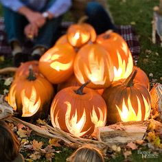 Set your pumpkins on fire with our cool pumpkin decorating idea. Mimic a bonfire with your pumpkins to make a fun focal point for your backyard. Our free stencil means this design is surprisingly easy, too.