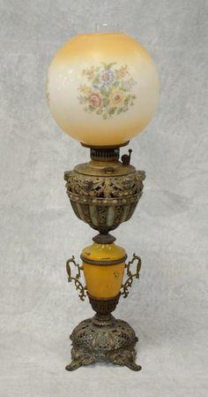 Victorian white metal banquet lamp, cherub decorated : Lot 7100