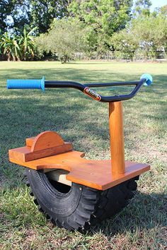 Motorcycle seesaw made out of tire and real race bike handles. We are thinking about adding light in front and little license plate to the back with his name