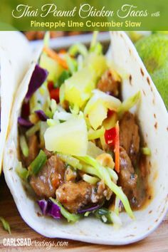 Thai Peanut Chicken Tacos with Pineapple Lime Cucumber Slaw - your favorite peanut chicken topped with refreshing sweet, citrusy, crunchy slaw.