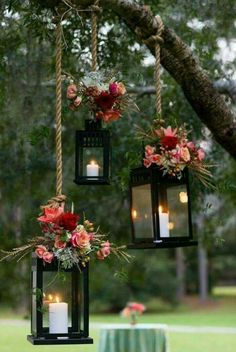 Hanging garden lanterns with rope and fish coloured flowers for a romantic outdoor wedding