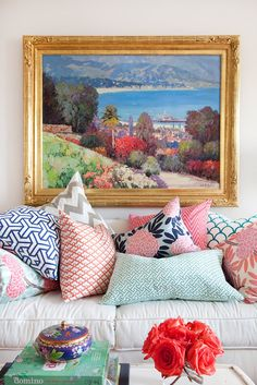 Eclectic & colorful mix of pillows will liven up your sofa for spring