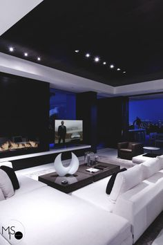 Penthouse Life| #black and white living #fireplace #great lighting