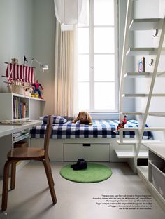 Kids room- built in bed frame with attached stairs to loft and additional sleeping space, large window, white basics.  Links to several small-space, multi-kid bedrooms