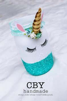 This listing is for (1) Unicorn Glass Jar in your choice of color **DESCRIPTION** Each glass jar has been painted white and glittered with either JUMBO GOLD, LAVENDER, TEAL, PINK or GOLD glitter. Each jar has been magically transformed into an enchanting unicorn with a miniature horn