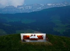 Guests in a room at the Null-Stern-Hotel (Zero-Star-Hotel) art installation by Swiss artists Frank and Patrik Riklin near Gonten, Switzerland. You can rent a room without walls or a ceiling for a night. REUTERS/Arnd Wiegmann