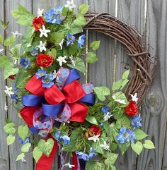 Fourth of July Wreath - Patriotic July 4th Wreath - Red White and Blue Wreath with Bow. $58.00, via Etsy.