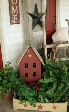 By the front door on a porch.if I had a porch Christmas Porch, Primitive Christmas, Christmas Decorations, Primitive Homes, Primitive Crafts, Primitive Country, Saltbox Houses, Bird Houses, Outdoor Rooms