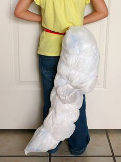 My Father's World K - D is for Dinosaur Dinosaur Tail Kids Game . . . so easy - trash bags and blocks.  They are going to love it!