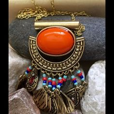 Orange &Gold Beaded Necklace Gold tone with a big orange bead with gold tone tear drop 3 have crystals pink and clear. Each tear drop has light blue red and dark blue little beads. It's very nice makes an outfit perfect. Very light around your neck.  LalasjewelryDesigns Jewelry Necklaces