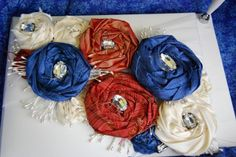 DIY guestbook using silk scraps from bridesmaid's dresses to create flowers for the front! Step-by-step directions on the post.