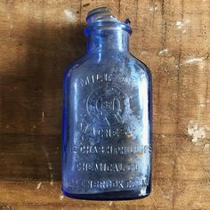 Your place to buy and sell all things handmade Blue Bottle, Vodka Bottle, Old Wine Bottles, Medicine Bottles, Wedding Table Centerpieces, Decoration, Vintage Items, Conditioner, Stains