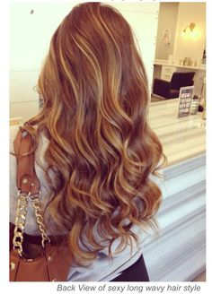 Blonde highlights mix with light red hair color More