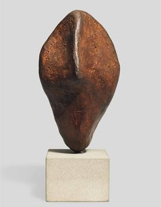 William Turnbull (1922-2012) Head I signed with monogram, numbered and dated '92/5/6' (on the reverse) bronze with a brown patina 9¼ in. (23.5 cm.) high, excluding stone base