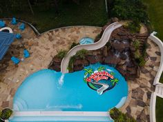 Aerial Shot of This one featuring a Paradise Slides, inc. #Poolslide model PS43L-C in Clay. This stunning project by Paragon Pools in Texas. Great looking project! #WaterSlide #SwimmingPoolSlide