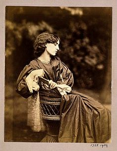 "Dante Gabriel Rossetti's 1865 photograph of Jane Morris in the same Pre-Raphaelite designed dress as shown in ""Mariana."""