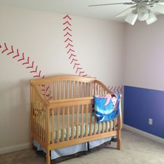 "Baseball room for a boy with ""never let the fear of striking out keep you from playing the game"" and a different crib"