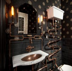 From Steampunk Tendencies. I have a slight plumbing/water phobia, so i don't know how I'd feel visiting this bathroom. Looks cool though!