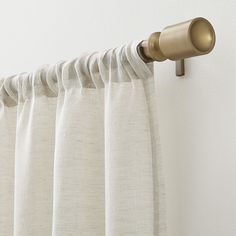 """Shop Barnes Antiqued Brass . 75""""dia. x28""""–48"""" Curtain Rod Set.  Modern square finial gets a timeless finish in antiqued brass powdercoat.  Telescoping rod sets include rod, finials, brackets and mounting hardware."""
