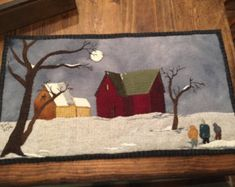 This is a wool appliqué of a snowman sharing his carrot nose with a little bunny. I placed the wool appliqué on a stretched canvas covering the canvas with pillow ticking. I also placed a small banner underneath with the words spirit of giving. 8.5x9