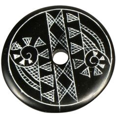 """Coal Pendant with Muisca Scroll #5  Crafted by Artisans in Colombia  Measures 1-3/4"""" diameter and 1/8"""" thick"""