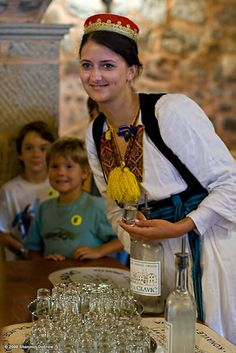 Young Girl Serving Grappa in Dubrovnik, Croatia., via Flickr. wondersoccertowel@gmail.com soccer a beautiful game