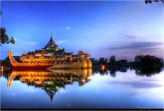 Karaweik Hall reflecting at sunset time by Chan Nyein Kyaw on 500px