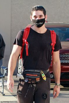 Out of this world! Alan Bersten carried some of belongings in a NASA belt bag
