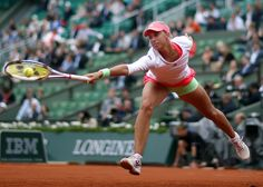Andrea Hlavackova of the Czech Republic plays a shot to Serena Williams of the U.S. during their women's singles match at the French Open tennis tournament at the Roland Garros stadium in Paris, France, May 26, 2015. REUTERS/Gonzalo Fuentes