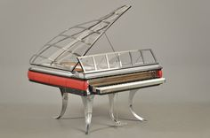 The Magnificent Grand Paino by Poul Henningsen, designed in 1931. Designed the Piano in steel, aluminum, red leather and plexiglass.