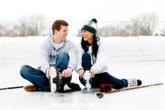 Hockey rink engagement picture.