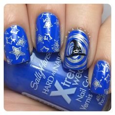 Wizard nails using Sally Hansen Hard as Nails Xtreme Wear Pacific Blue stamped using Bundle Monster BM-209, BM-320, and BM-418 in Sally Hansen Insta-Dri Silver Sweep and Bundle Monster Noir Black.