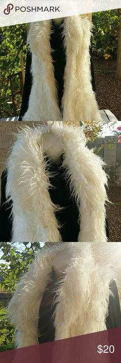 Last Kiss Faux Fur Vest Pre-owned : gently used condition. No rips, tears, or stains.  Super soft faux fur vest, long shaggy fur, inside pocket, and 4 hook and eye closures up and down front. 18 inches across chest, armpit to armpit 29 inches from shoulder to bottom hem line   Feel free to ask questions or request different pictures. All items are from a smoke free but pet friendly home.   Reduce. Reuse. Recycle. Last Kiss Jackets & Coats Vests
