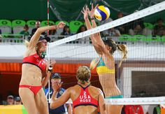 Power spike:    Kerri Walsh of the United States fires a ball past Australia's Mariafe Artachoof during a women's beach volleyball preliminary-round match on Aug. 6.