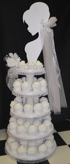 for a bridal shower (minus the lace/ribbon on tiers - solid satin ivory/party theme colour ribbon in lieu) - for a bachelorette party, ALL black (including the cupcake wrappers) and used either stark white or party theme colour icing.