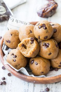 These tasty no-bake Paleo cookie dough bites are made with real-food ingredients, sweetened with dates and bananas and pack a punch of Paleo friendly protein along with the taste and texture of chocolatechip cookie dough!