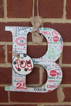 front door decor family initial wreath by scrapartbynina on Etsy, $12.00