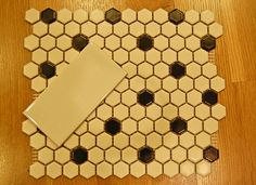 American Olean 1″ hexagonal tile — white with black dot — paired with the 3″x6″ AO artic white subway tile