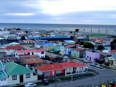 Section of Punta Arenas city. In the background is the recently built Seaside Walkway. In the horizon is the Strait of Magellan.