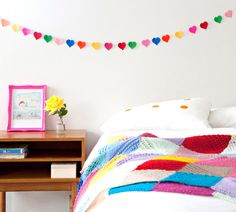 Simple and colorful bedroom.  I like the pink picture frame.