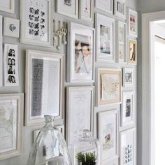 A Wall of photos Polaroids / travel paraphernalia